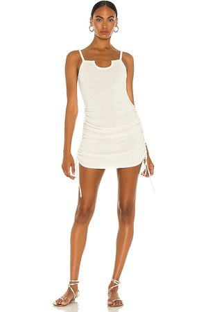 JoosTricot Half Moon Mini Dress in Ivory.