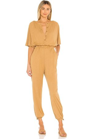 Lovers + Friends Karina Jumpsuit in Tan.