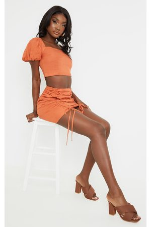 PRETTYLITTLETHING Tall Rust Ruched Bodycon Skirt