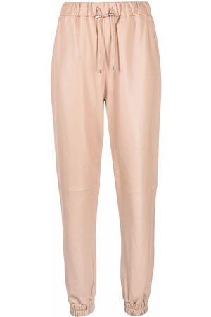 Philipp Plein Women Leather Pants - Leather drawstring jogging bottoms - Neutrals