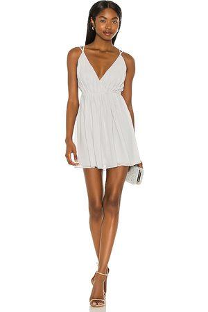 Michael Costello X REVOLE Etta Mini Wrap Dress in Light Grey,Slate.
