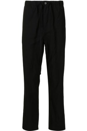 CRAIG GREEN Tapered-leg relaxed trousers