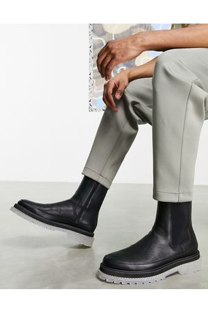 ASOS Chelsea calf boots in faux leather with clear chunky sole