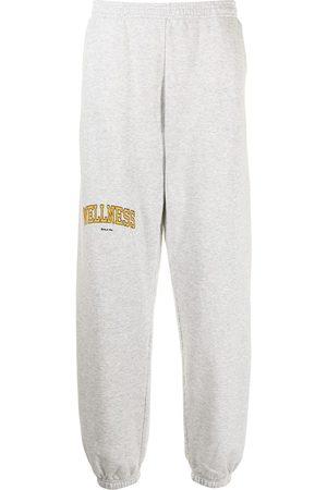 Sporty & Rich Slogan-print cotton track pants - Grey
