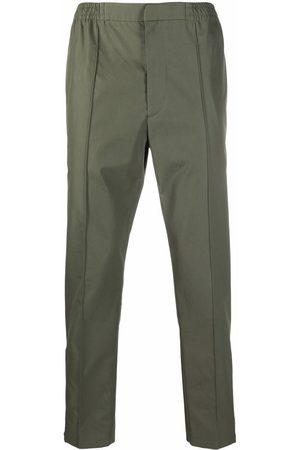 Alexander McQueen Logo-strap trousers