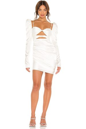 The Bar Twist Dress in Ivory.