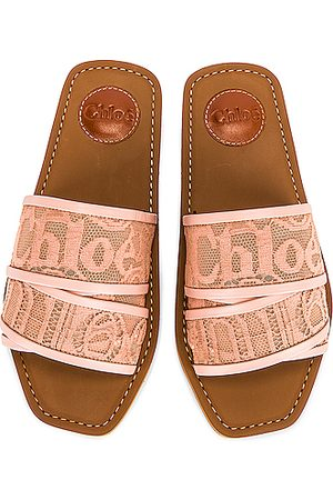 Chloé Woody Lace Slides in Blush