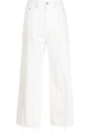 SJYP Frayed seam denim trousers