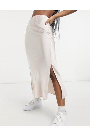 ASOS Satin bias slip midi skirt with splits in soft pink
