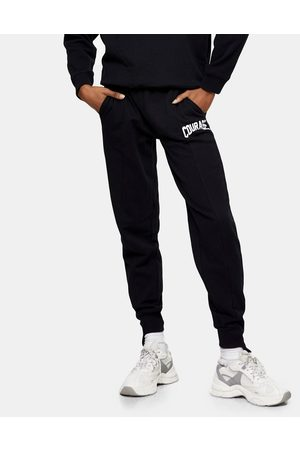 Topshop Women Sweatpants - Oversized cuffed sweatpants with collegiate Courage leg graphic in black