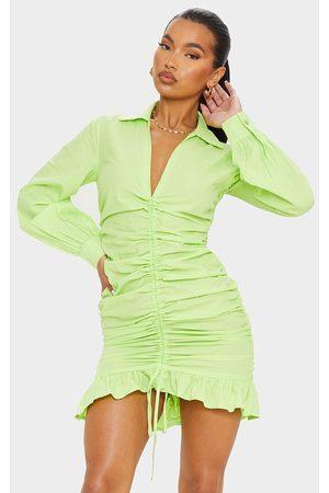 PRETTYLITTLETHING Lime Long Sleeve Ruched Frill Hem Shirt Dress