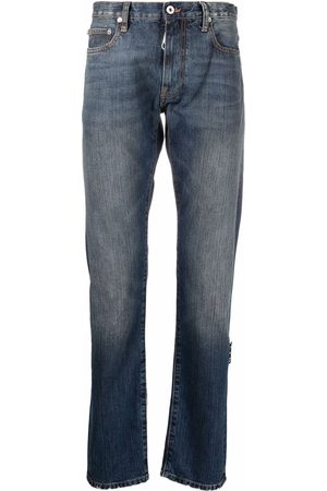 OFF-WHITE Faded-effect slim-cut jeans