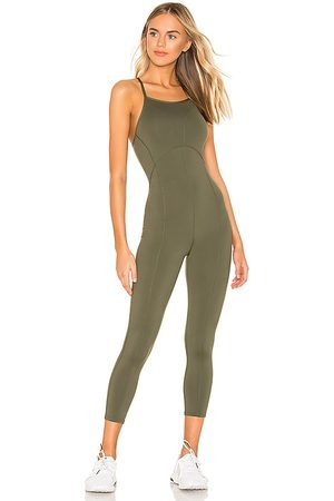 Free People X FP Movement Side To Side Performance Jumpsuit in Olive.
