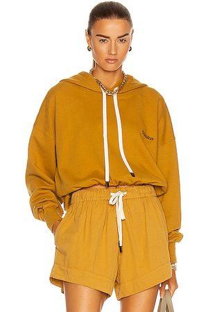BASSIKE Branded Cropped Hooded Sweatshirt in Mustard