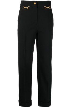 Moschino Cavalry horsebit-detail trousers