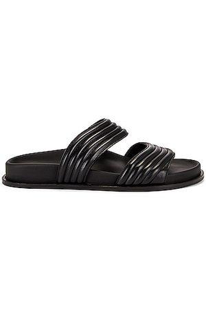 Alaïa Leather Slides in