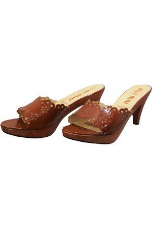 Miu Miu Patent leather Mules & Clogs