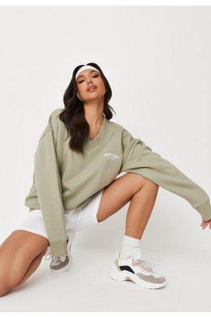 Missguided Khaki Graphic V Neck Oversized Sweatshirt