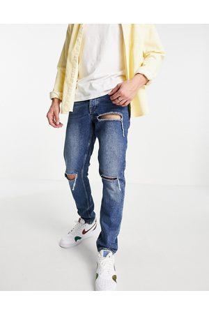ASOS Slim jeans in vintage dark wash with rips