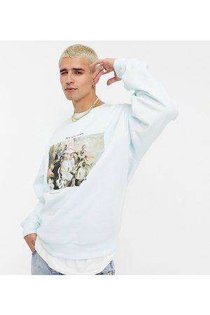 Reclaimed Inspired art print sweatshirt in light blue