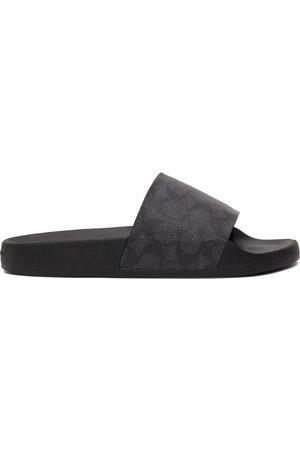 Coach Black Signature Slip-On Sandals
