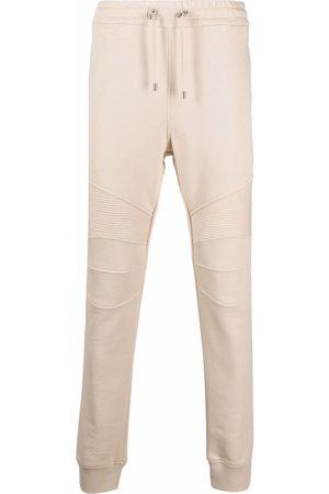Balmain Two-tone monogram-print track pants - Neutrals