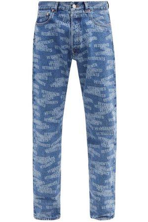 Vetements Monogram-print Slim-leg Jeans - Mens