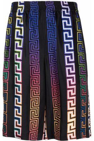 VERSACE Men Bermudas - Greca Neon-print silk shorts