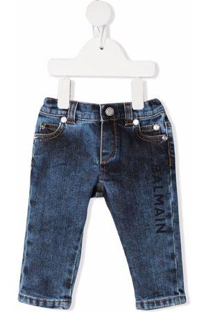 Balmain Logo-print distressed-effect jeans