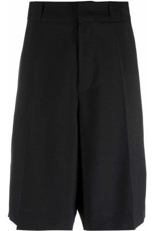 VALENTINO Men Shorts - Tailored knee-length shorts