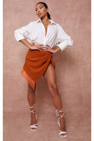 PRETTYLITTLETHING Women Party Dresses - Burnt Twist Front Tassel Hem Mini Skirt