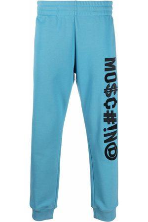 Moschino Men Sweatpants - Symbols logo-embroidered fleece track pants
