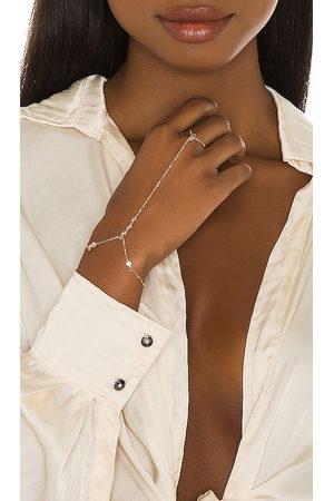 Lili Claspe Anais Hand Chain in Metallic .