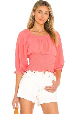 1. STATE Scoop Neck Ruched Blouse in Coral.