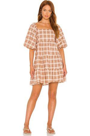 FAITHFULL THE BRAND Eryn Mini Dress in Brown.