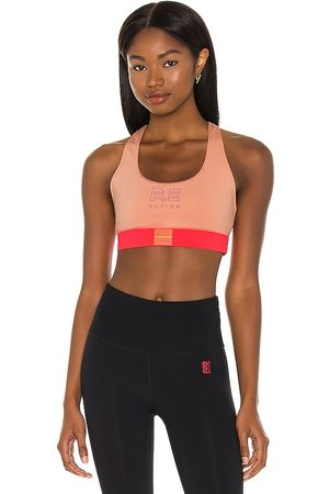 P.E Nation Box Out Sports Bra in Coral.