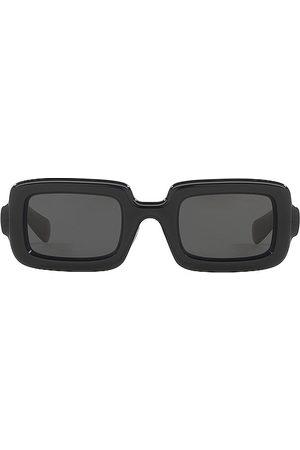 Miu Miu Square Frame Sunglasses in Black.