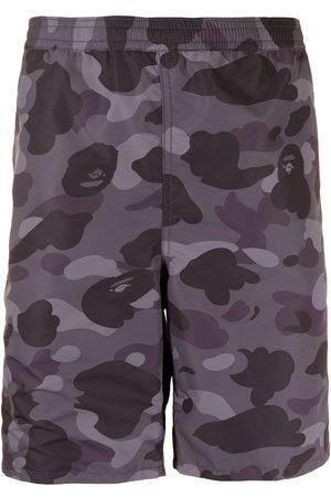A Bathing Ape Men Shorts - Camouflage-print knee-length shorts