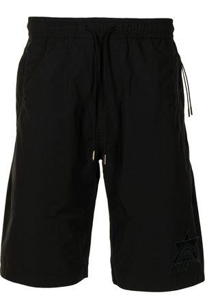 Maharishi Men Shorts - Logo-embroidered shorts