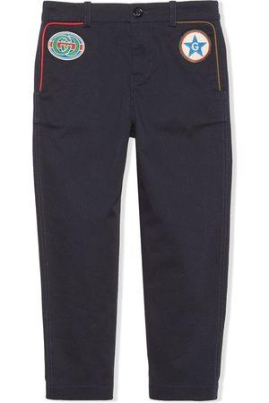 Gucci Stretch-gabardine star patch trousers
