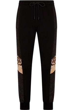 Dolce & Gabbana Men Sweatpants - Leopard print track pants