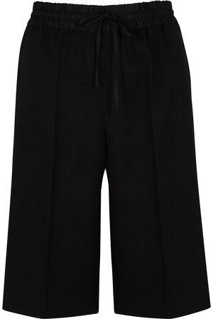 Jil Sander Women Shorts - Longline wool shorts