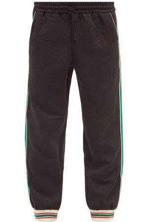 Gucci Web-stripe Gg-jacquard Jersey Track Pants - Mens