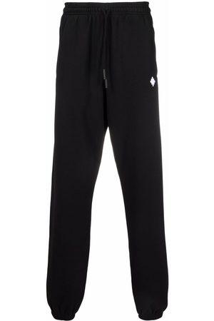 MARCELO BURLON Men Sweatpants - Logo-embroidered track pants