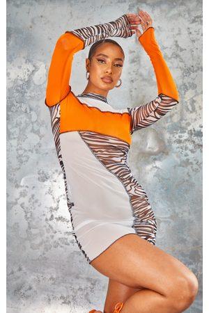 PRETTYLITTLETHING Zebra Mesh Contrast Overlock Stitch Asymmetric Hem Bodycon Dress