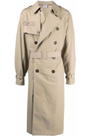 Vetements Double-breasted belted trench coat - Neutrals