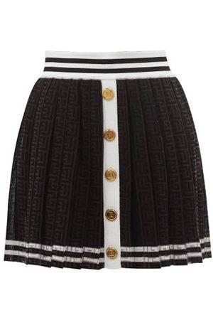 Balmain Pleated Monogram-jacquard Jersey Mini Skirt - Womens