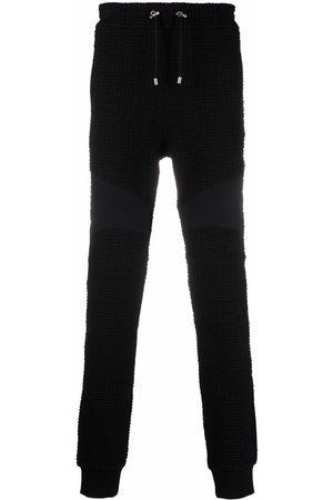 Balmain Monogram-pattern track pants
