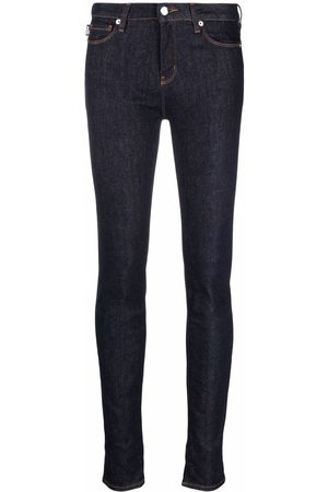 Love Moschino Logo-studded skinny jeans