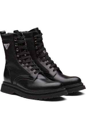 Prada Logo-plaque panelled ankle boots